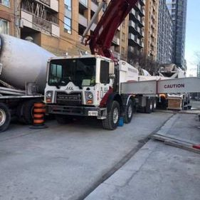 Concrete pre-mix truck with concrete pumping truck